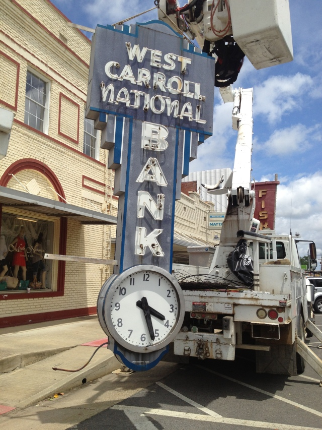 WCNB CLOCK COMES DOWN TO BE RESTORED