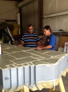 Photo Caption: Chamber Special Events and Preservation Coordinator Adam Holland and Ken Mobley discuss status of progress on WCNB Clock restoration at Ken's Kustoms Body Shop in Oak Grove.  The Chamber hopes to transport the clock to Carter Signs in Bastrop, La. in the coming weeks to finish its restoration.
